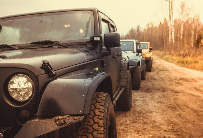 3 jeep wranglers off roading
