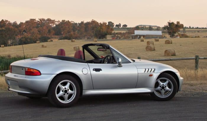 silver bmw z3 on road