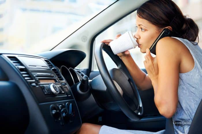 Using phone while driving car