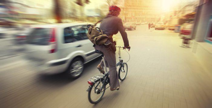 biking in city traffic