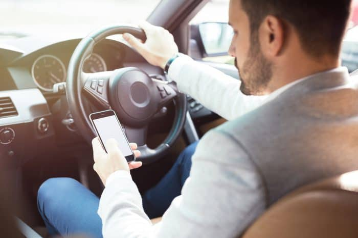 Guy Texting While Driving