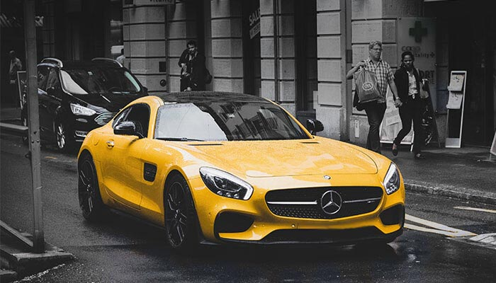 yellow sports car in city