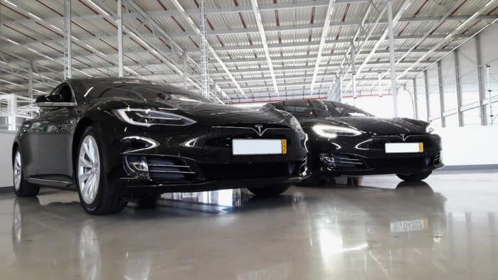 two black tesla model s