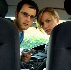 parents looking at kids in car