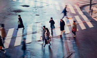 pedestrians crossing the street in crosswalk
