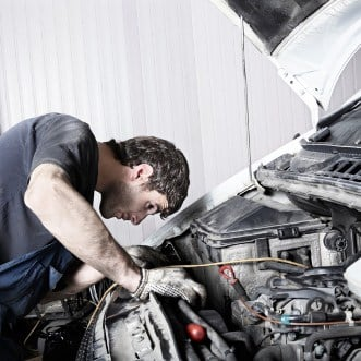 auto mechanic repairing a car engine