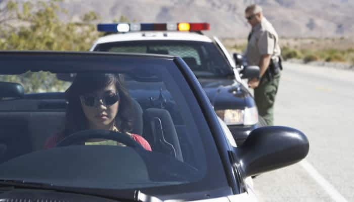 Woman sitting in car after receiving speeding ticket