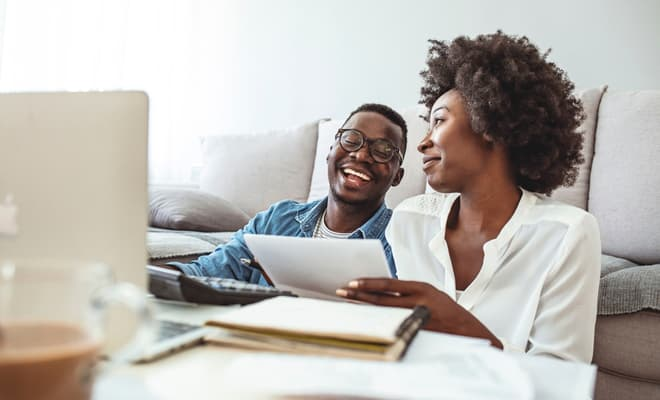 young couple look at paperwork to learn how to cancel gap insurance