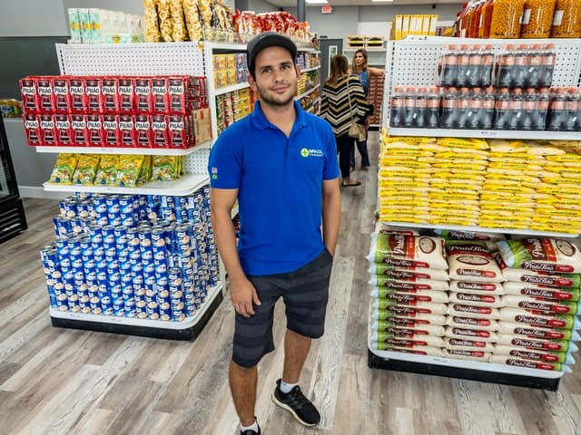 man working at grocery store