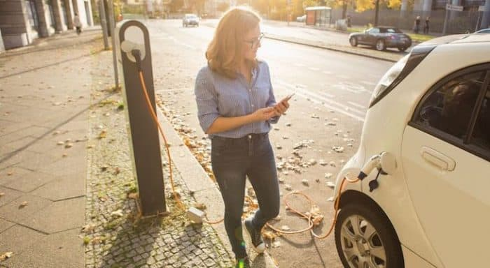 Woman charges her electric car