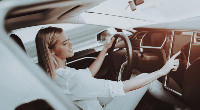 Woman in an electric car