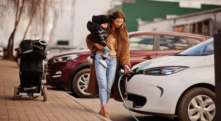 Woman charging a PHEV