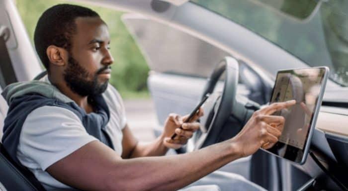 Man using a phone in his car