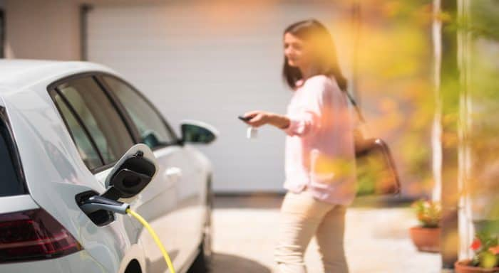 Woman charges her EV
