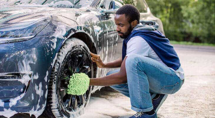 Man washing his electric car