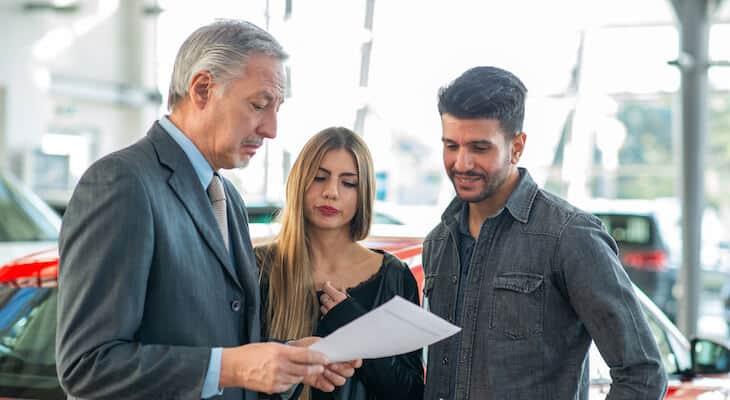 Salesperson explains an EV lease deal