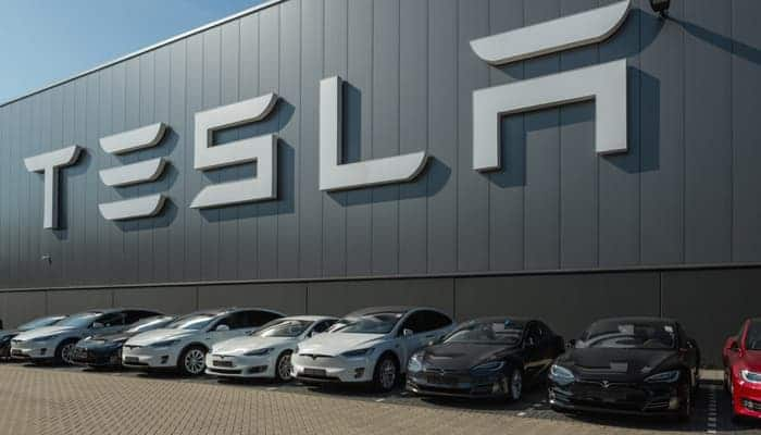 A row of used Teslas at the dealership