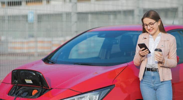 Woman charges a Tesla alternative