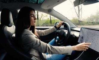 Woman uses touchscreen in Tesla