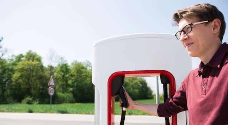 Man at Tesla charging station