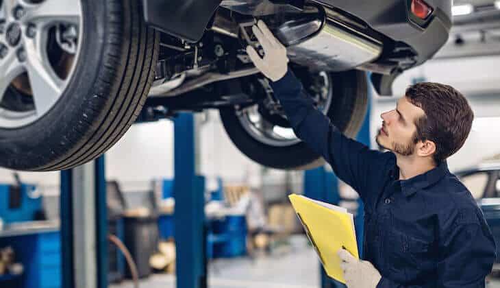 Mechanic examines an electric car