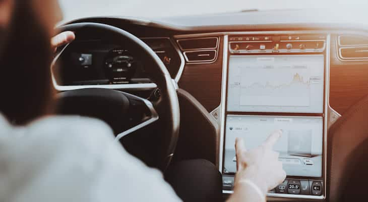 Man uses Tesla touchscreen
