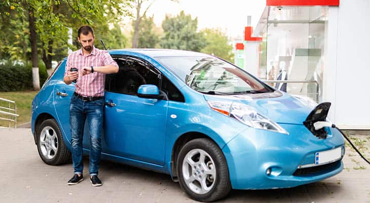 Man with an early model Nissan LEAF