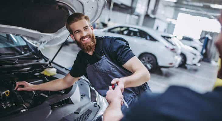 Mechanic works on electric vehicle