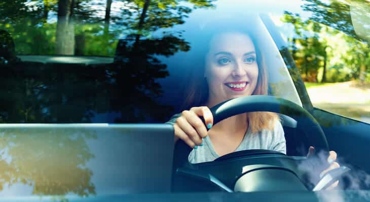 Woman drives a Tesla Model 3