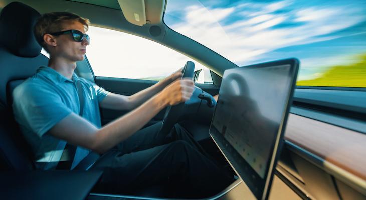 Model S vs Model 3: Man driving Tesla