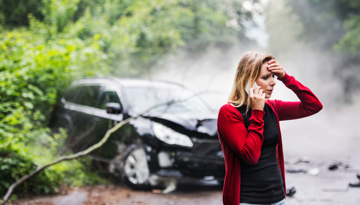 Woman after car crash discussing how to file a car insurance claim (1)