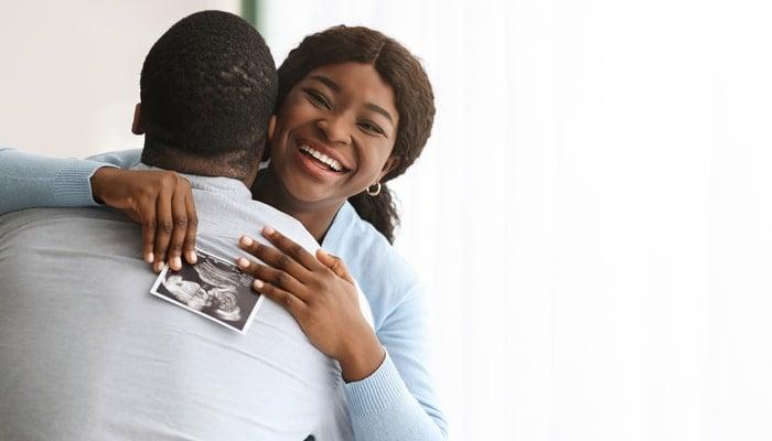 Couple celebrates ultrasound results