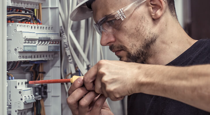 EV charger installation: electrician fixing a switchboard