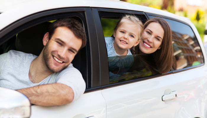Family riding together in a car that has a cheap liability insurance policy