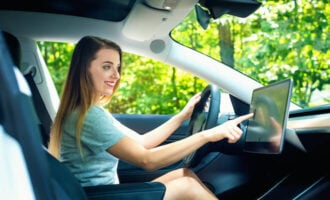 Best Tesla model: woman happy with her electric car